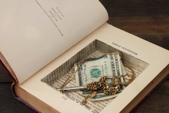 Hollowed out book with valuables