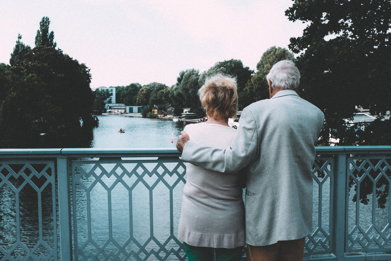 old couple on a bridge